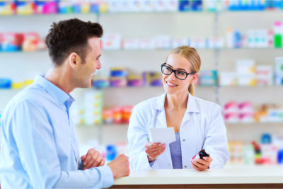 Pharmacist and the customer talking